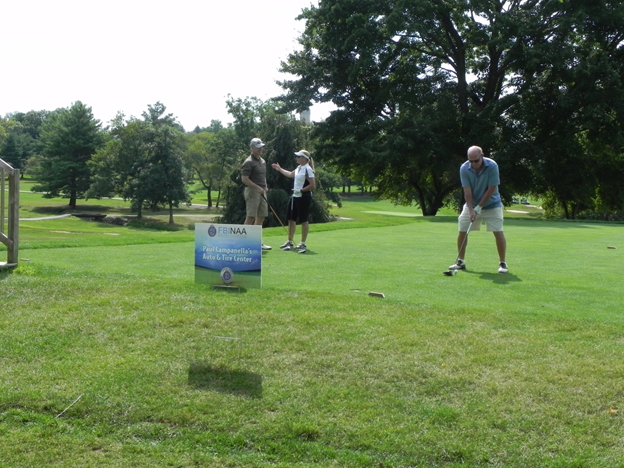Speaker of the Delaware House of Representatives Pete Schwartzkopf tees off at the tournament with teammates RL Hughes (left) and Laura O??Sullivan waiting