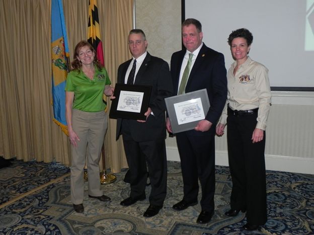 President Walter (left) and 1st Vice President Melissa Zebley present certificates of appreciation to Major Waren Hyatt and Lt David DelVecchia of Connecticut State Police after their moving Sandy Hook presentation